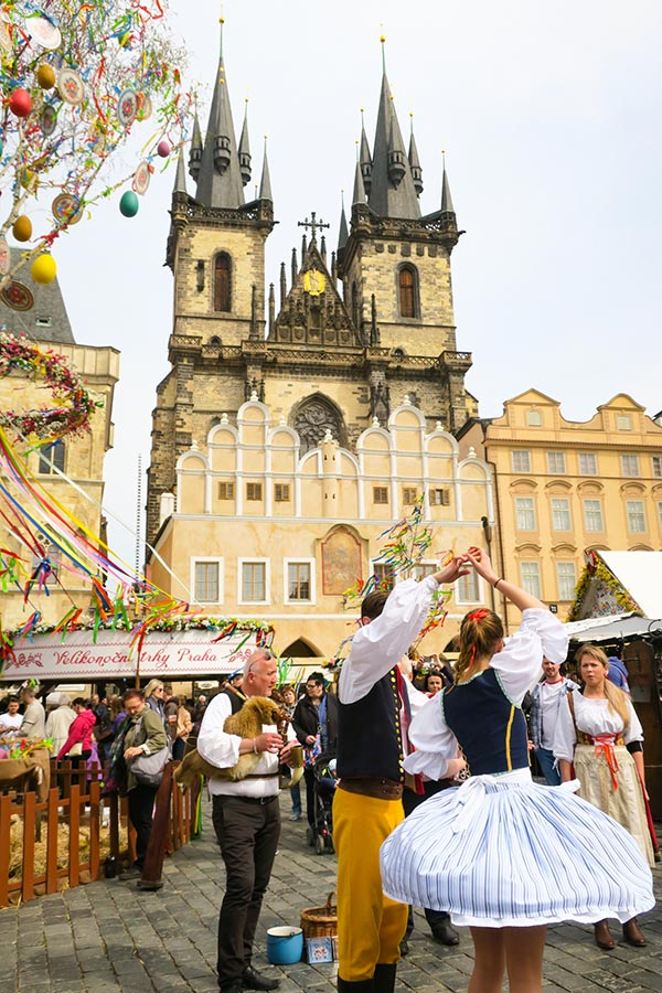 People dancing in traditional clothes at Prague Easter Market at Prague's Old Town Square