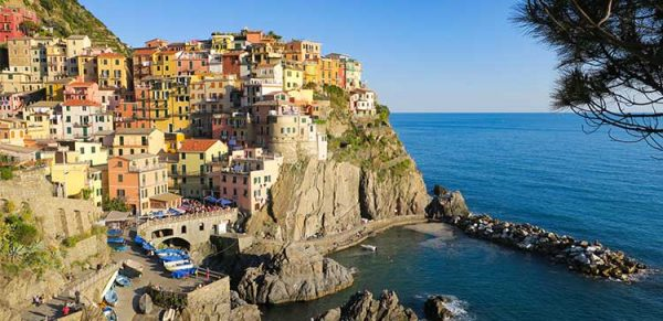 Colourful houses of the village of Manarola. How to get to Cinque Terre Italy?