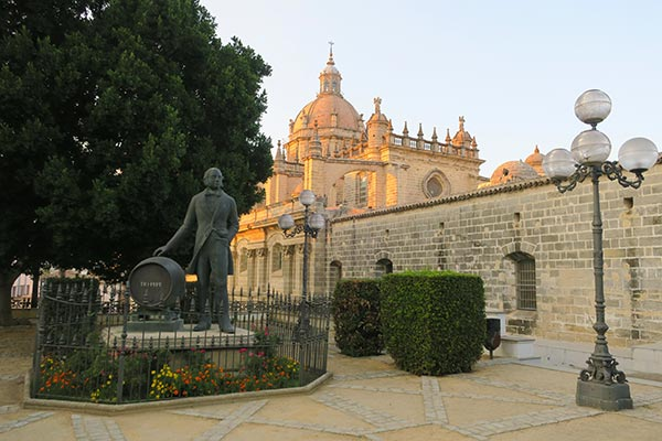 Cathedral of Jerez during sunset with the statue of Tio Pepe and the sherry wine barrel. I took this picture after my Sherry Tour in Jerez